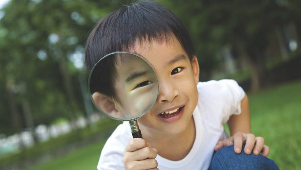 helena-clayton-leadership-boy-with-magnifying-glass